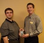 Jon handing iPod to winner